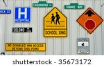 multiple traffic signs on a wall | Shutterstock . vector #35673172