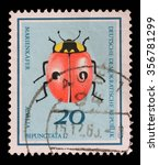 Small photo of CIRCA 1968: A stamp printed in Germany from the Useful Beetles issue shows two-spot ladybird beetle (Adalia bipunctata), circa 1968.
