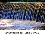 Closeup Of A Weir Waterfall