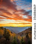 Stock photo autumn sunrise and dramatic sky over oconaluftee overlook in the smoky mountains 356886869