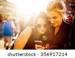 girlfriends with a smart phone | Shutterstock . vector #356917214