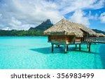 luxury overwater thatched roof... | Shutterstock . vector #356983499