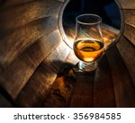a glass of whiskey in oak... | Shutterstock . vector #356984585
