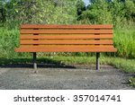 A Wooden Bench Offers A Place...