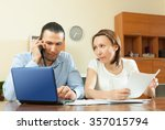 adult couple calling by mobile... | Shutterstock . vector #357015794