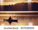 the man rowing oars in boat of... | Shutterstock . vector #357028505