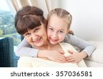 senior lady with granddaughter... | Shutterstock . vector #357036581