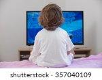 little boy sitting on bed... | Shutterstock . vector #357040109
