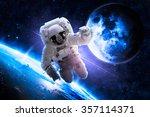 astronaut over earth   elements ... | Shutterstock . vector #357114371