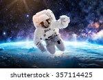 astronaut over earth   elements ... | Shutterstock . vector #357114425