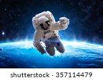astronaut over earth   elements ... | Shutterstock . vector #357114479