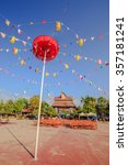 Small photo of CHIANGRAI,THAILAND - JANUARY 1 : The big red umbrella with national flags of Southeast asia countries, AEC, ASEAN Economic Community in public park on January 1, 2016 in Chiangrai,Thailand