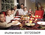 the family at the table at... | Shutterstock . vector #357203609