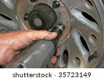 mechanic using impact wrench to ... | Shutterstock . vector #35723149