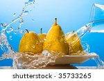 Water pouring on yellow pears. Macro - stock photo