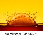 A slice of orange in juice. Macro - stock photo