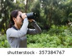 woman use of the binoculars at... | Shutterstock . vector #357384767
