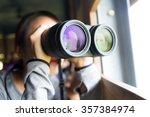 young woman using binoculars...   Shutterstock . vector #357384974