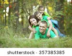 happy family resting in a... | Shutterstock . vector #357385385