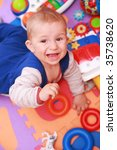 crying baby with lot of toys | Shutterstock . vector #35738620