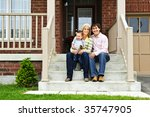 young family sitting on front... | Shutterstock . vector #35747905