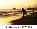 Surfer Walking On The Beach At...