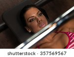 young latina woman in gym... | Shutterstock . vector #357569567