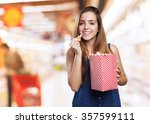 young cute woman eating popcorn | Shutterstock . vector #357599111