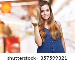 young woman doing a rich gesture | Shutterstock . vector #357599321