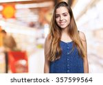 young woman smiling over white... | Shutterstock . vector #357599564