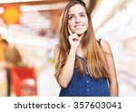 young woman thinking over white ... | Shutterstock . vector #357603041