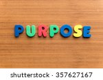 Small photo of purpose colorful word on the wooden background