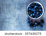 organic fresh dark berries in