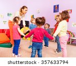 teacher and group of kids in... | Shutterstock . vector #357633794