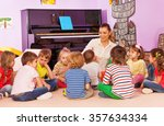 group of kids sit and listen to ... | Shutterstock . vector #357634334