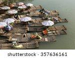bamboo rafts on the li river. | Shutterstock . vector #357636161