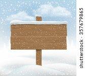 wooden signboard in snowbank.... | Shutterstock .eps vector #357679865