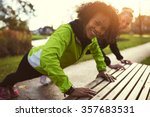 two smiling sportswomen doing... | Shutterstock . vector #357683531