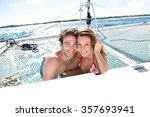 Cheerful Couple Relaxing On...