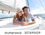 couple laying on a sailboat... | Shutterstock . vector #357695429