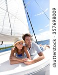 couple laying on a sailboat... | Shutterstock . vector #357698009