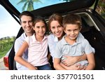 family sitting in car trunk ... | Shutterstock . vector #357701501