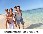 parents giving piggyback ride... | Shutterstock . vector #357701675