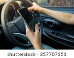 woman holding phone in car | Shutterstock . vector #357707351