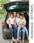 family sitting in car trunk ... | Shutterstock . vector #357708191