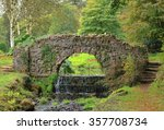 Stone Bridge Crossing A Stream...