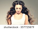 model with long hair. waves... | Shutterstock . vector #357725879