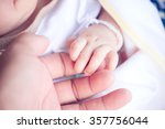 new born baby hand vintage tone ... | Shutterstock . vector #357756044