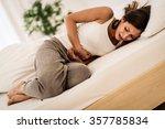 beautiful young woman lying on... | Shutterstock . vector #357785834