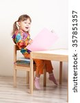 happy girl sitting on stack of... | Shutterstock . vector #357851357